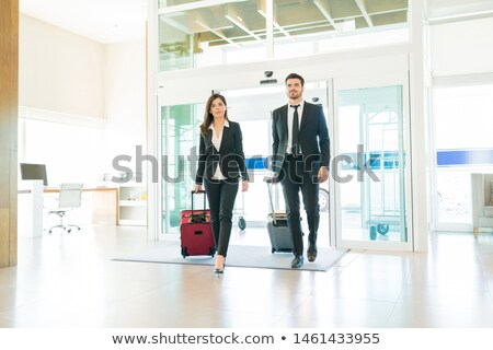 nő · bőrönd · egészalakos · vonzó · nő · fehér · munka - stock fotó © stockyimages