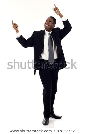 Businessman holding up his business card Stock photo © photography33