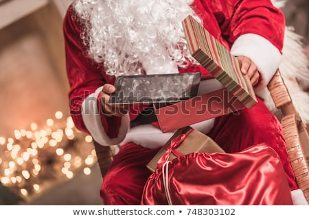 Digital tablet with christmas present Stock photo © manaemedia