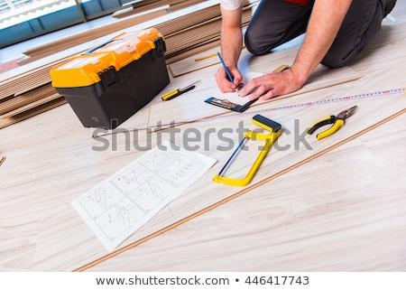 Handyman laying laminate floor Stock photo © photography33