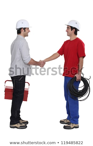 duo of plumbers shaking hands Stock photo © photography33