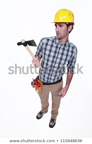 A handyman looking weirdly at his hatchet. Stock photo © photography33