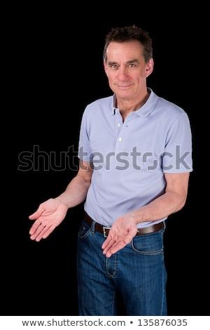 Smiling Man Hands Forward Demonstrating Something Stock photo © scheriton