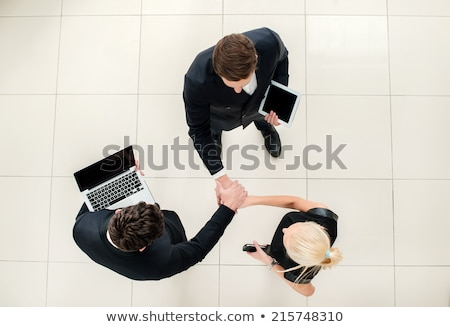 Three business people folding their hands Stock photo © wavebreak_media