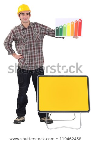 Tradesman standing before a blank sign and holding an energy efficiency rating chart Stock photo © photography33