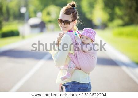 Fiatal anya baba csúzli lány kék Stock fotó © luckyraccoon