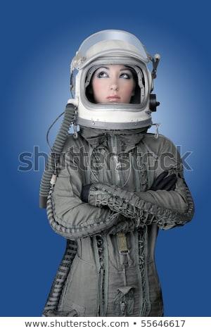 Astronauta astronave aeronaves casco moda mujer Foto stock © lunamarina