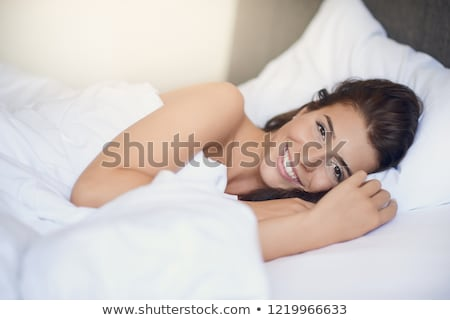 Vivacious young woman in bed Stock photo © dash