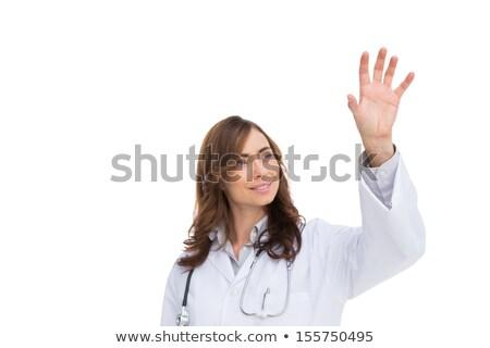 женщины врач указывая вверх воздуха улыбаясь Сток-фото © fantasticrabbit