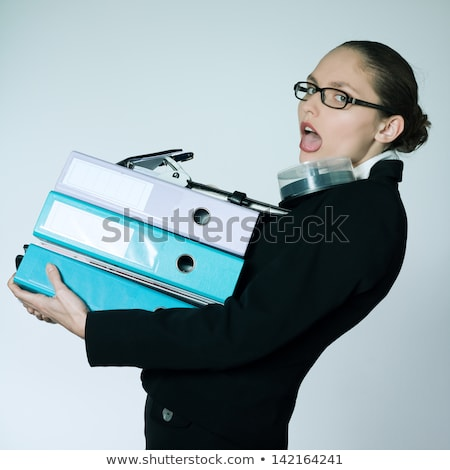 studio shot portrait of businesswoman carrying heavy files and folders stock photo © pxhidalgo