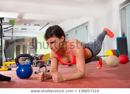 exercising elbow pushups with dumbbells stock photo © rob_stark