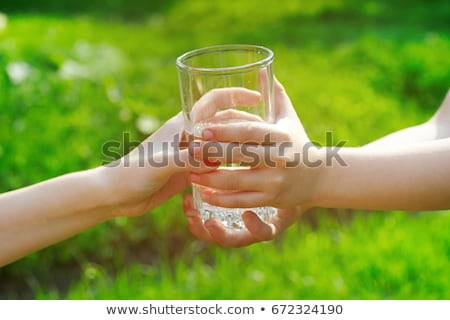 thirsty man drinks out of a glass in the outdoor garden Stock photo © meinzahn