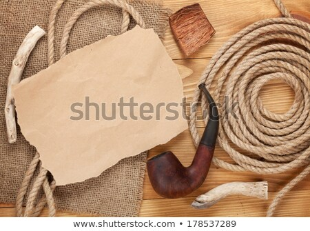 paper piece for copy space and tobacco pipe stock photo © karandaev