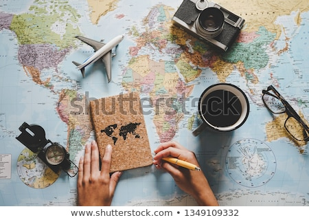 Young traveller with globe Stock photo © monkey_business