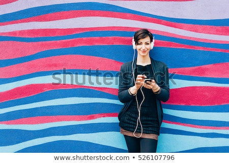 Blond woman listening to the music Stock photo © Nejron