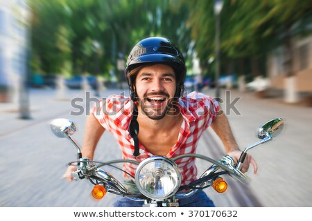 young man riding old retro scooter stock photo © dashapetrenko