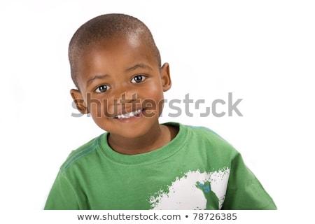 Bonitinho menino sorridente olhando preto Foto stock © alexandrenunes