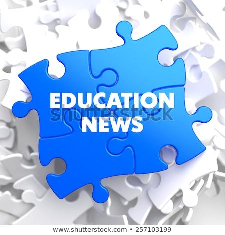 Education News on Blue Puzzle. Stock photo © tashatuvango