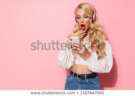 Young pretty blonde woman posing Stock photo © dariazu