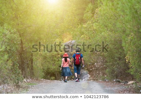 Two beautiful women walking along the flower alley Stock photo © konradbak