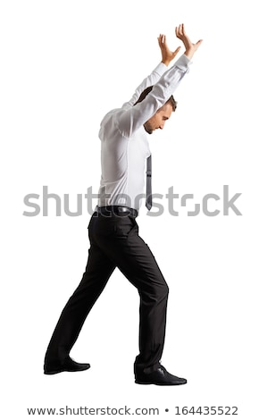 A serious businessman lifting something  Stock photo © wavebreak_media