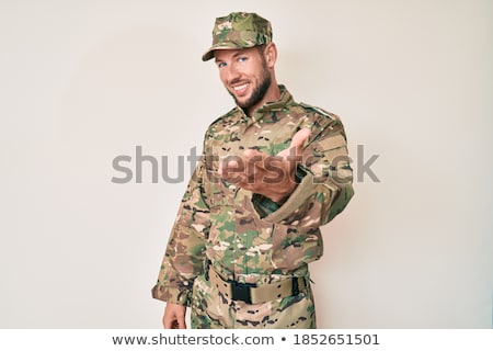 man in camouflage greets stock photo © paha_l