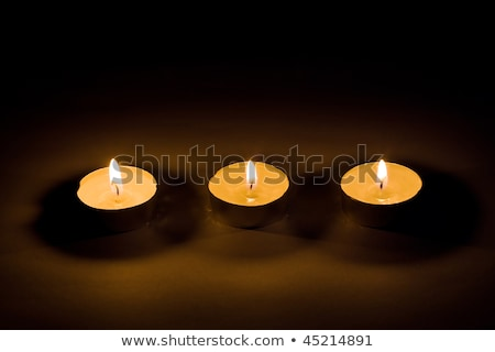 Three Lit Candles for a bottom border on black. Stock photo © rojoimages
