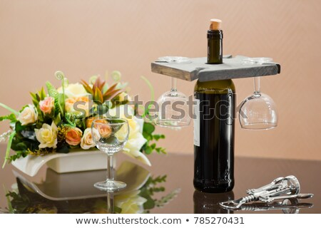 wine glasses hanging upside down on bar holder Stock photo © dolgachov