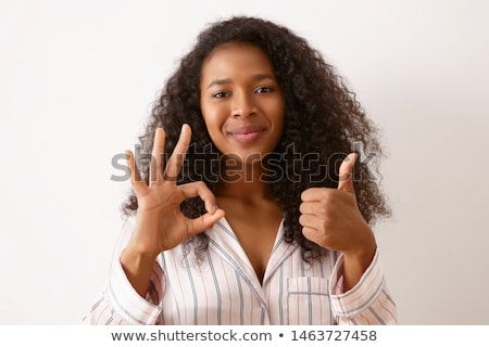 Foto stock: Young Woman Making Ok Hand Gesture