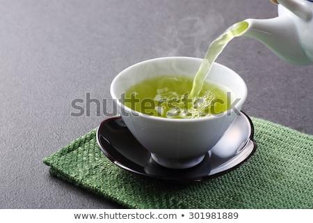 Thé vert théière pierre table haut Photo stock © karandaev