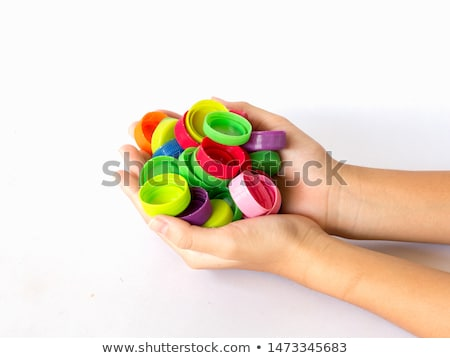 Cap from the bottle in the child's hand. stock photo © EFischen