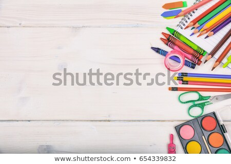 Colored pencil crayons and a blank notebook Stock photo © ozgur