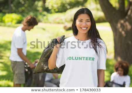 volunteers helping with litter stock photo © lightsource