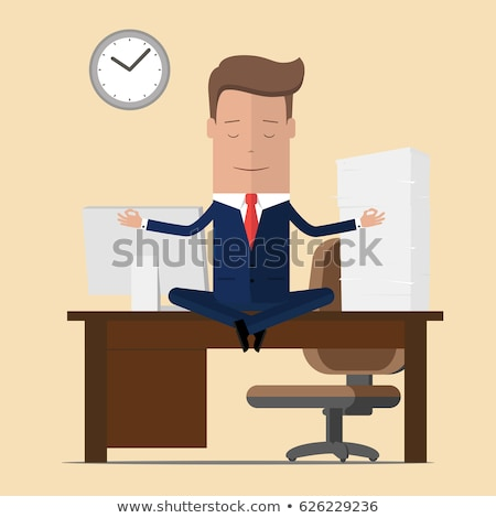 Stock photo: Businessman meditating in lotus position.