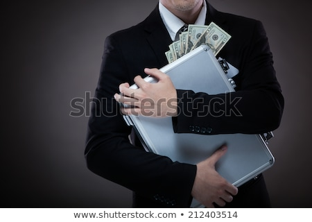 Businessman carrying briefcase full of money. Stock photo © RAStudio
