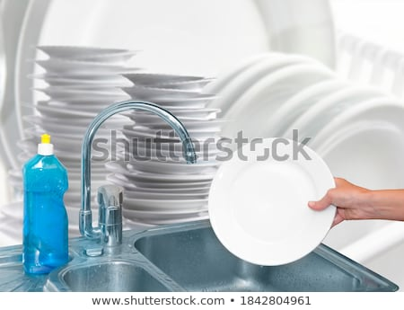 Empty white ceramic dish on over blue and yellow background, rec Stock photo © CaptureLight