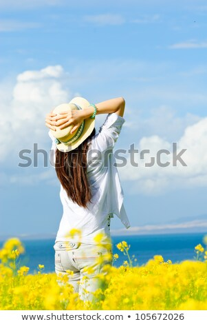 Happy woman in field of golden canola Stock photo © lovleah