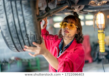 woman in a garage Stock photo © ssuaphoto