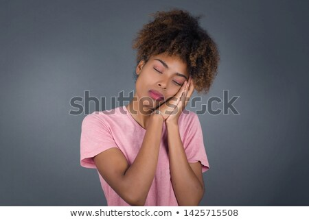 portrait of a young woman standing and pretending sleep stock photo © deandrobot