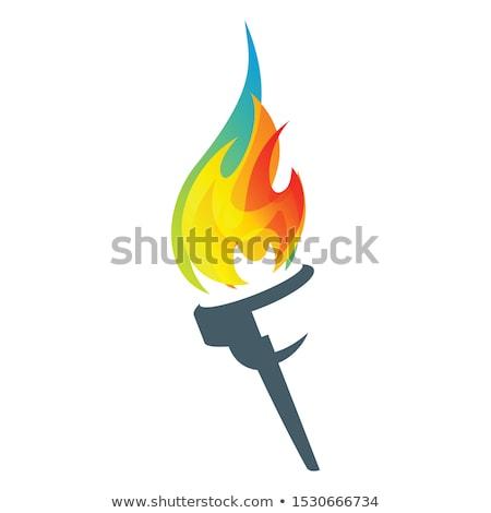 Antorcha metal amarillo llama cielo azul fuego Foto stock © pancaketom