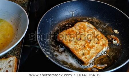 Serpenyő sült francia kenyér szeletek zsemle Stock fotó © Digifoodstock