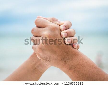 Man vrouw arm worstelen gebaar werken tabel Stockfoto © julenochek
