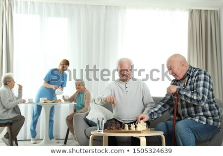 female doctor serving food to senior man at retirement home stock photo © wavebreak_media