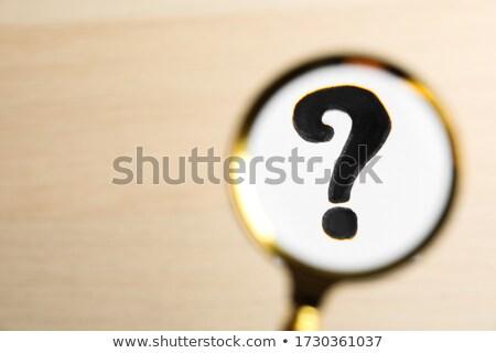 Who We Are Question through Magnifier. Stock photo © tashatuvango