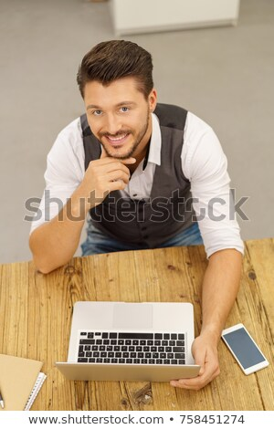 High angle portrait of smiling young creative professionals sitting on floor with sheets Stock photo © wavebreak_media
