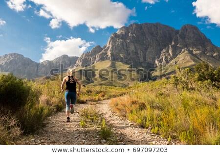 jonge · vrouw · lopen · berg · parcours · zonsondergang · mooie - stockfoto © blasbike