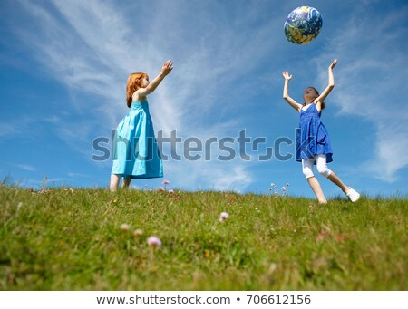2 young girls throwing inflatable globe Stock photo © IS2