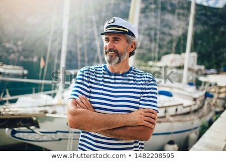 человека · лодка · глядя · кораблекрушение · воды · морем - Сток-фото © is2