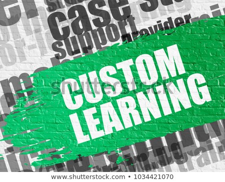 custom learning on white brickwall stock photo © tashatuvango