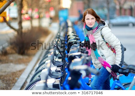 Woman on a bike ready to cycle in park Stock photo © IS2